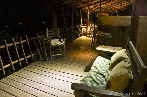 The deck at night at Lukwe Ecocamp